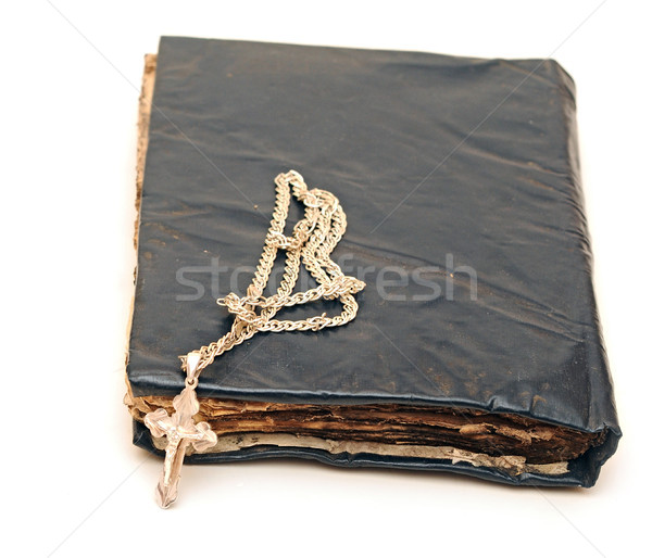 Religion. A cross with a chain against a old book Stock photo © inxti