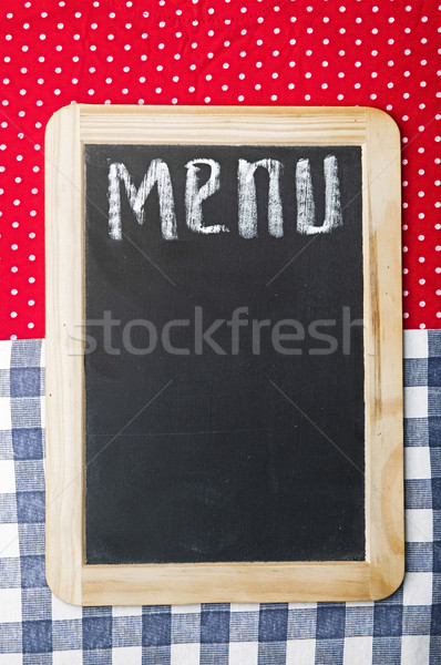 Menu title written with chalk on blackboard lying on tablecloth  Stock photo © inxti
