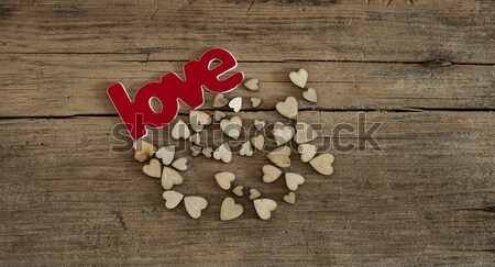 wood spoon and many hearts on wooden desk Stock photo © inxti