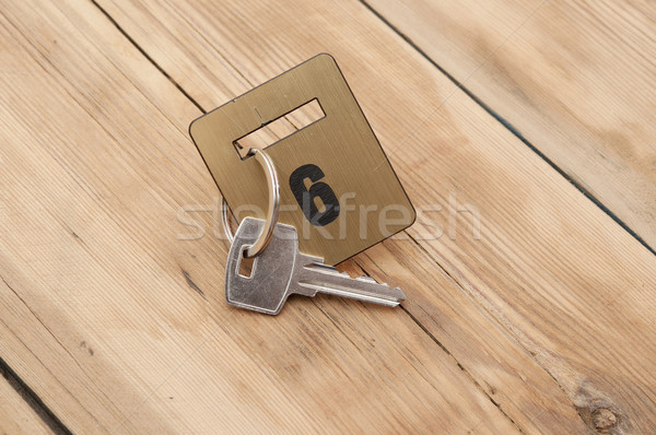 Hotel suite key with room number 6 on wood table  Stock photo © inxti