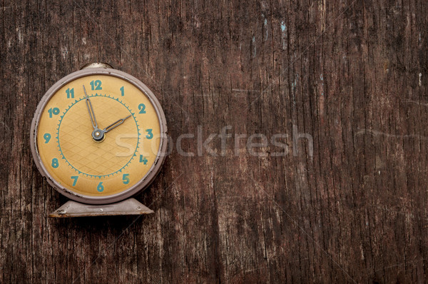 Vintage background with retro alarm clock on table Stock photo © inxti