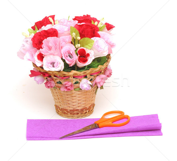 Paper flower in a basket with colorful paper and scissors  Stock photo © inxti