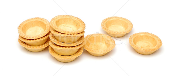 empty tartlets isolated on white Stock photo © inxti