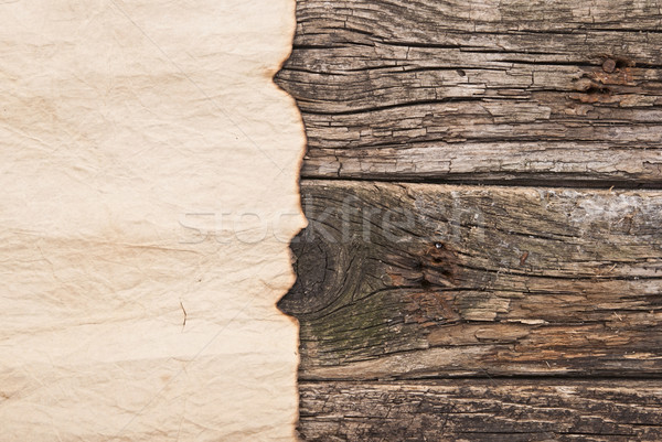 Burned old paper on border wood background  Stock photo © inxti