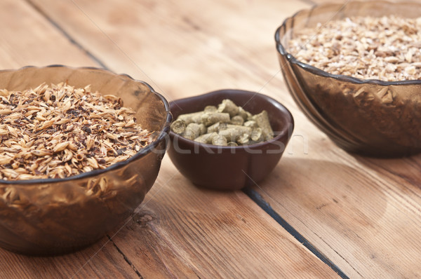 Stock photo: beer ingredients, hops and malt on wooden table top