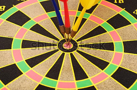 Dartboard with three darts in a bulls eye  Stock photo © inxti