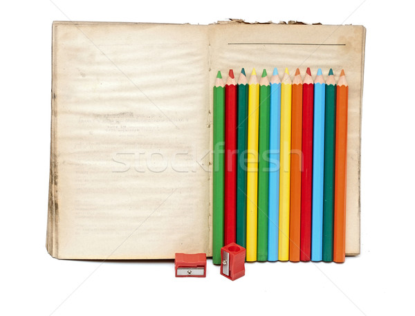 Wooden color pencils and old book on white background Stock photo © inxti