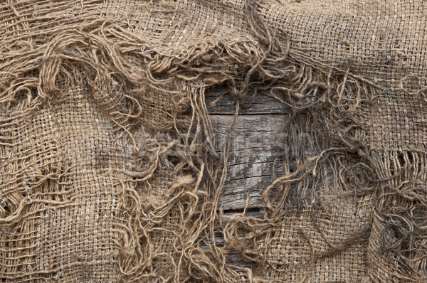 background of burlap with a hole for writing text. texture of th Stock photo © inxti