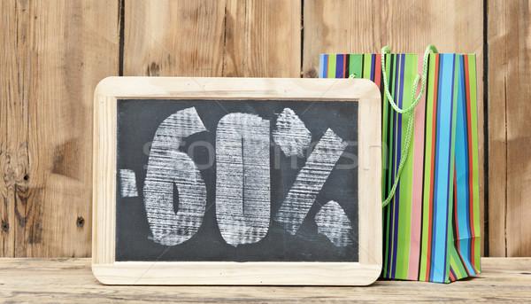 Zestig procent korting geschreven Blackboard kleurrijk Stockfoto © inxti