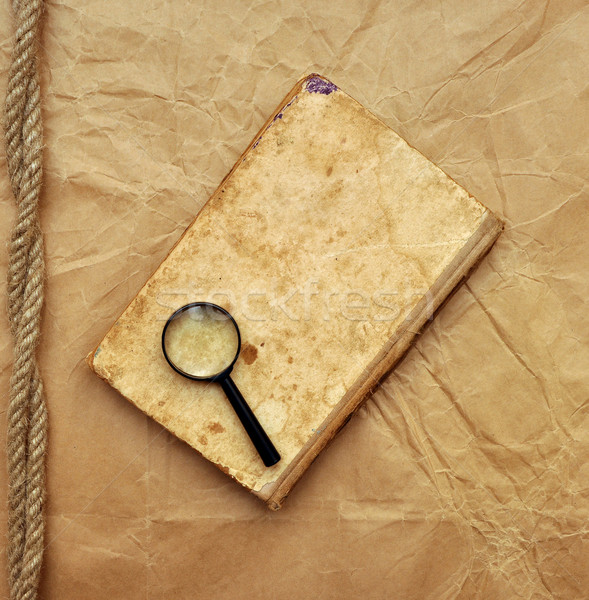 Libro viejo lupa papel viejo mano libro fondo Foto stock © inxti