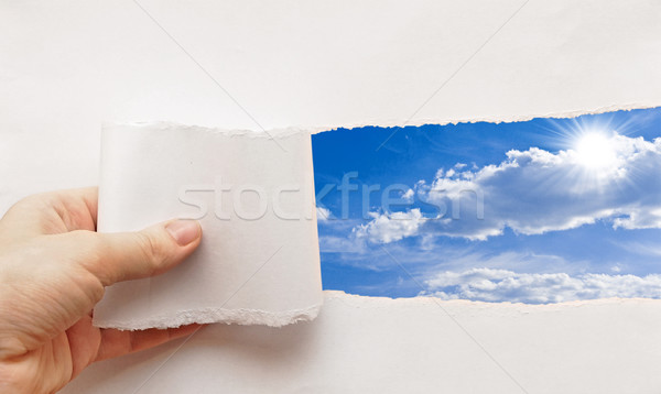 blue sky behind torn paper Stock photo © inxti