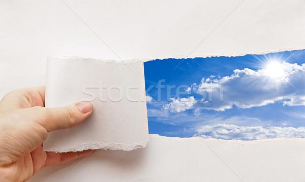 Blauwe hemel achter gescheurd papier papier voorjaar zon Stockfoto © inxti