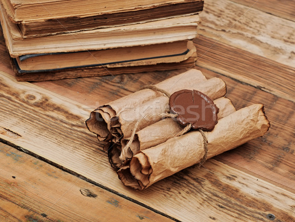 Pile of old books and scroll on wood background Stock photo © inxti
