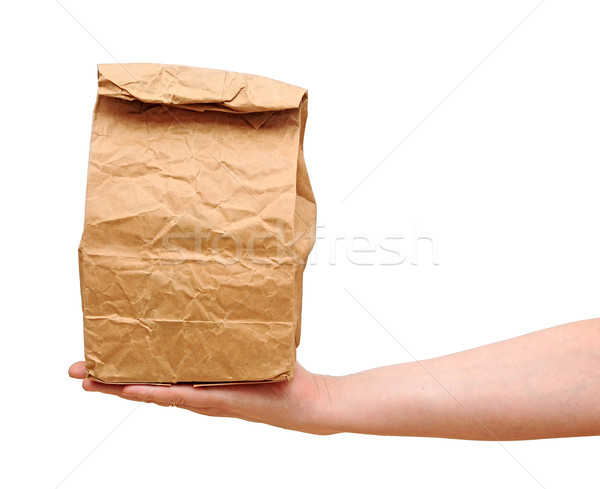 female holding a brown paper bag with contents in his hand Stock photo © inxti