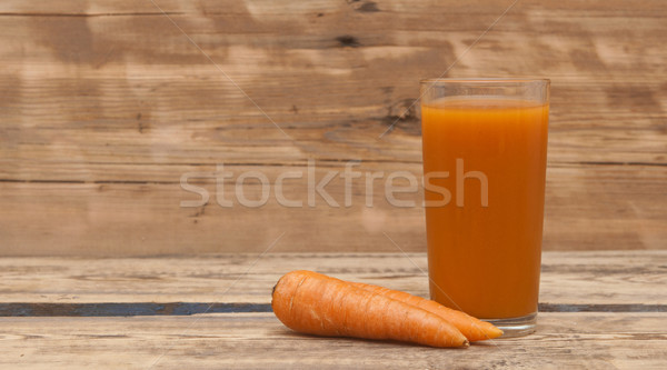 carrot juice and ripe carrot on a wooden background  Stock photo © inxti