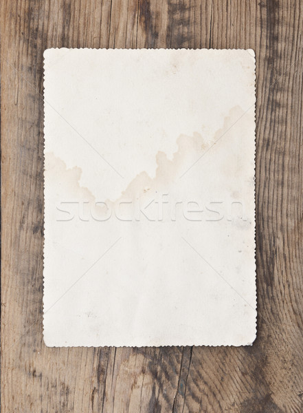 close up of an old photo on a wooden background Stock photo © inxti