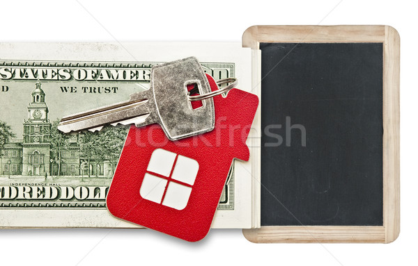 House keys and blank blackboard over the hundred dollar banknote Stock photo © inxti