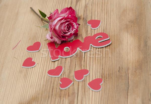 Rosa fiore petali parola amore rustico Foto d'archivio © inxti