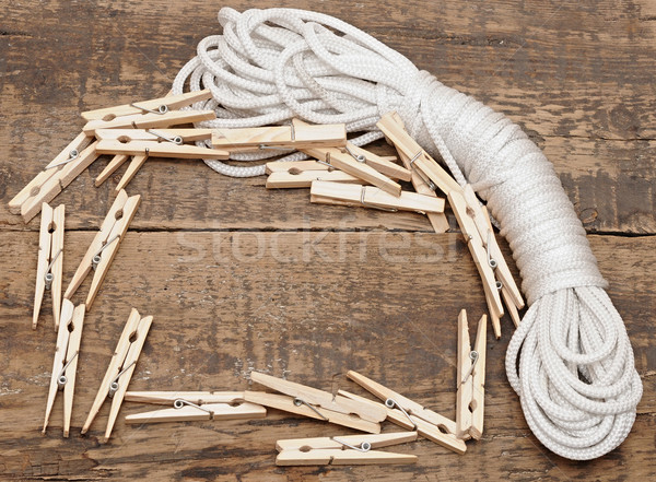 clothespins on rope on wooden background Stock photo © inxti