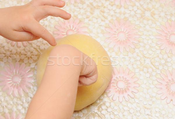 Child's hands kneading dough  Stock photo © inxti