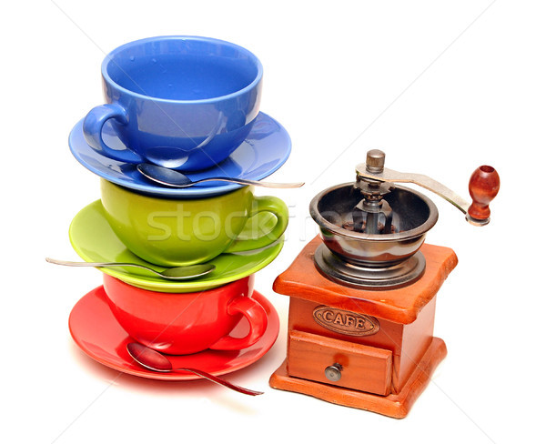 Stock photo: Colorful coffee mugs with coffee mill isolated on white