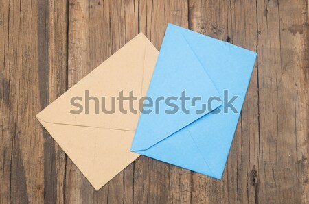 Stock photo: colorful envelopes lying on old wooden table