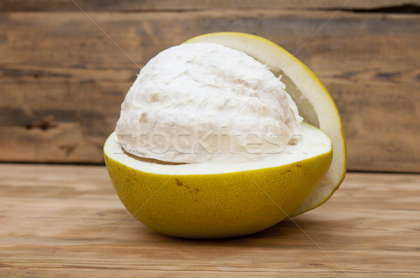 pomelo on old wooden table Stock photo © inxti