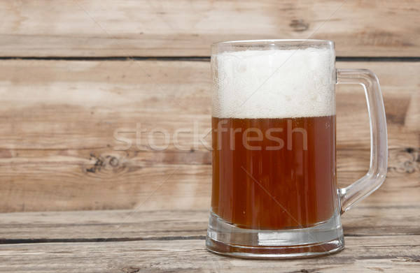 Mug of beer close up on wooden table  Stock photo © inxti