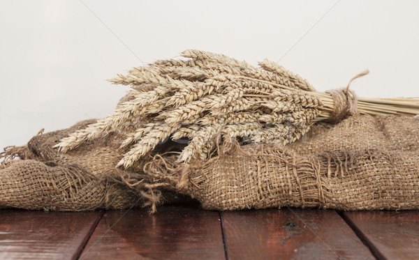 Bunch of ripe wheat on wooden table Stock photo © inxti