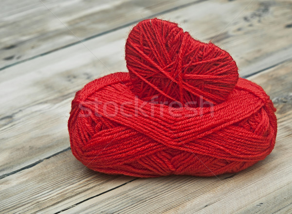 Knitted heart and red of yarn on wood background Stock photo © inxti