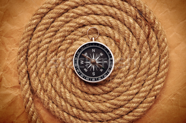 Rope coil with compass in the center  Stock photo © inxti