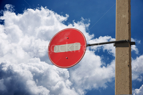 Prohibition traffic sign against the sky with clouds  Stock photo © inxti
