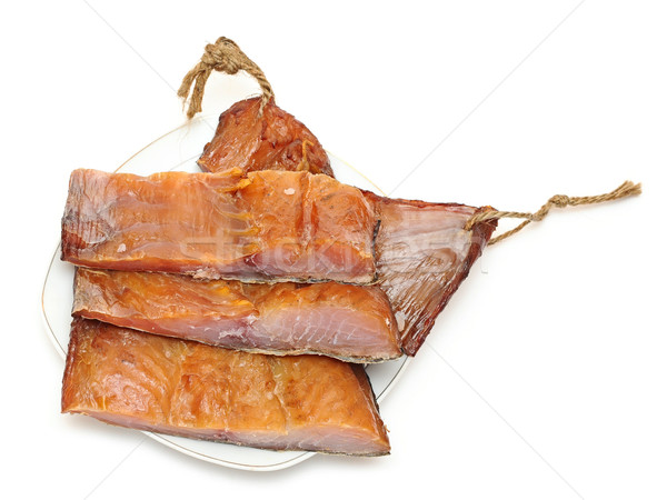 pieces smoked fish and cup of beer on a white background Stock photo © inxti