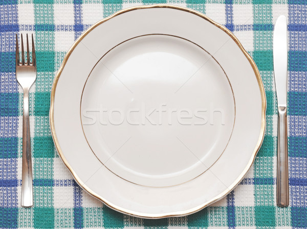 Knife, white plate and fork on blue checked tablecloth  Stock photo © inxti