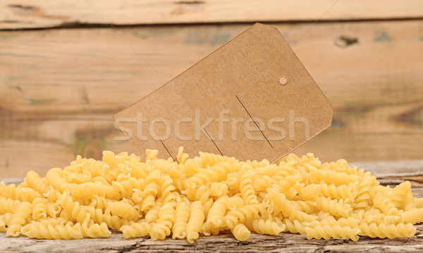 pile fusilli pasta with blank tag on wood background  Stock photo © inxti