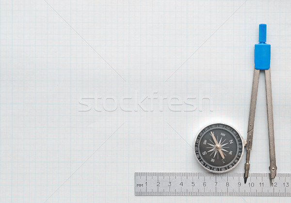compass and pencil on graph paper Stock photo © inxti