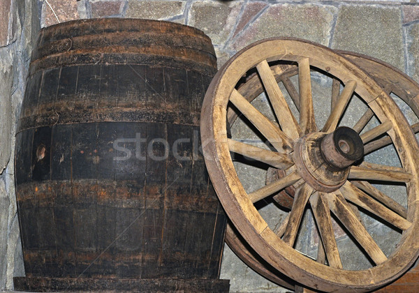 Wooden wagon wheel and barrel Stock photo © inxti