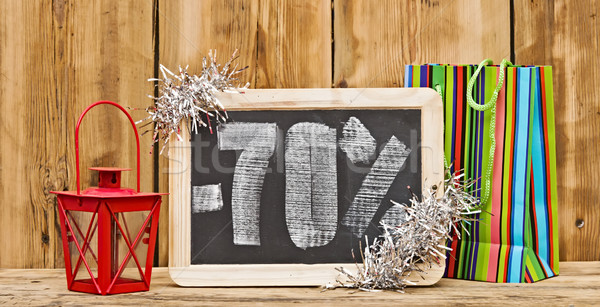 seventy percent discount written on blackboard with christmas de Stock photo © inxti