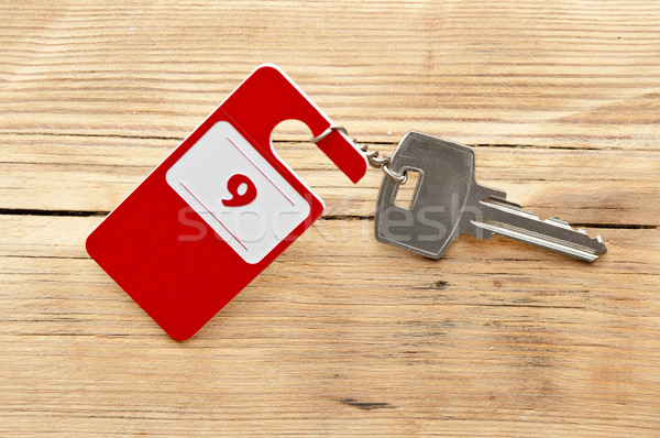 Hotel suite key with room number 9 on wood table  Stock photo © inxti