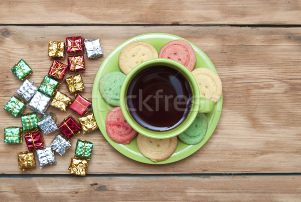 Gifts boxes with a colorful happy birthday cookie and tea cup Stock photo © inxti