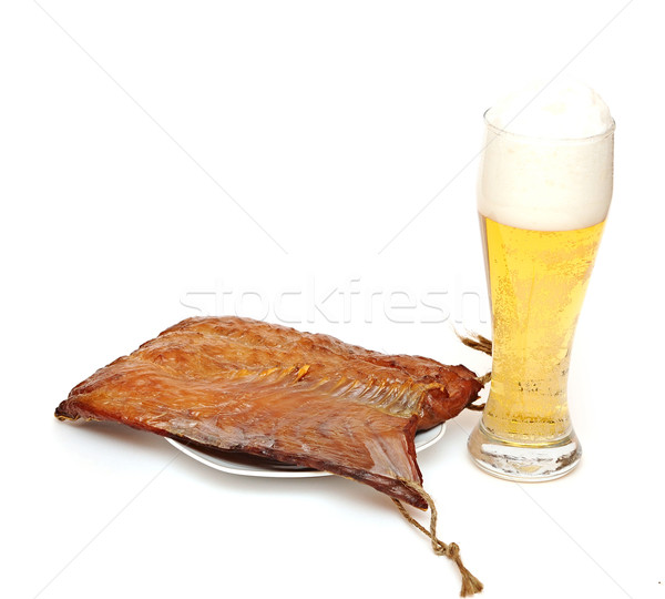 Stock photo: smoked fish and cup of beer on a white background