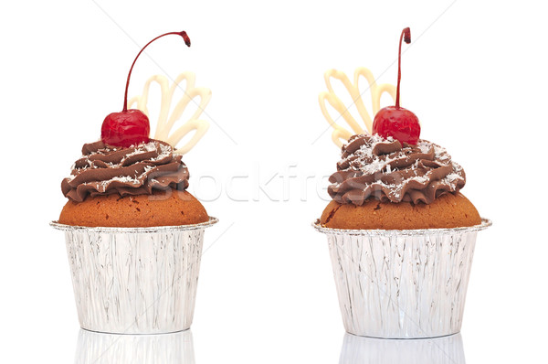 Muffins in a container  with chocolate cream, cherries and crumb Stock photo © inxti