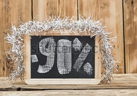 seventy percent discount written on blackboard  Stock photo © inxti