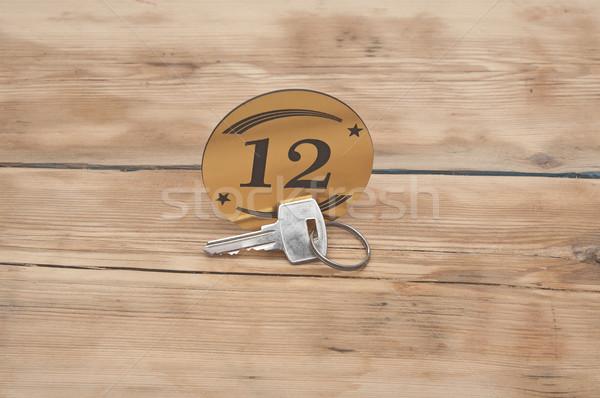 Hotel lakosztály kulcs szoba szám 12 Stock fotó © inxti