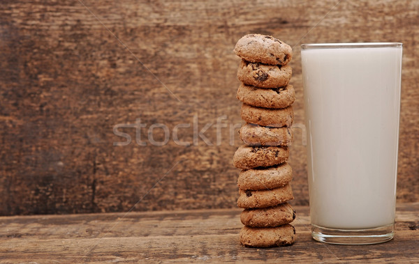 glass of milk and cookies on wooden table Stock photo © inxti
