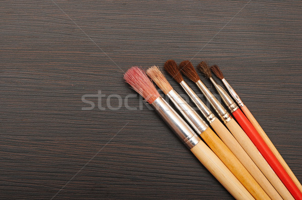 Paint brushes on dark wooden background Stock photo © inxti