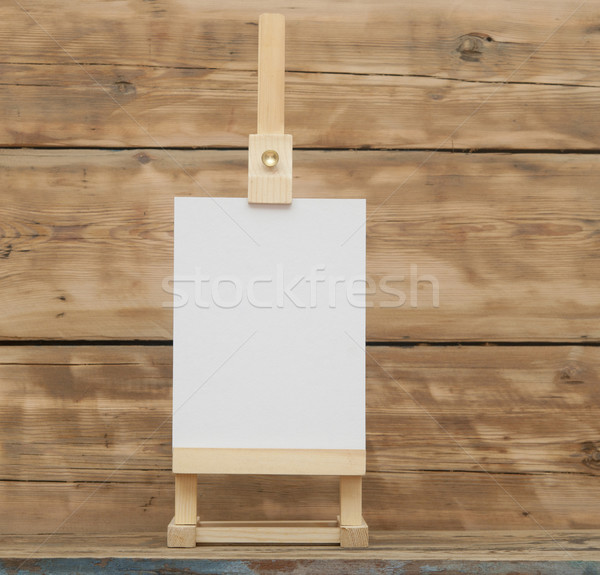 blank canvas on wooden easel againt wooden background  Stock photo © inxti