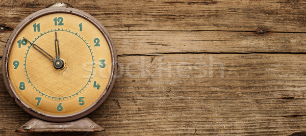 Retro clock with ten minutes to twelve o'clock Stock photo © inxti