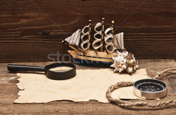 old paper and model classic boat on wood background Stock photo © inxti