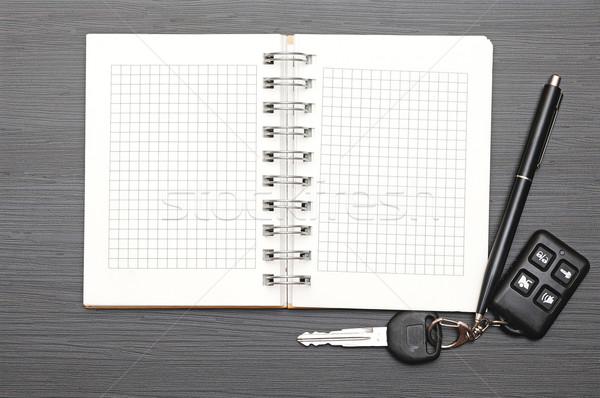 Keys on notepad on dark wooden background Stock photo © inxti
